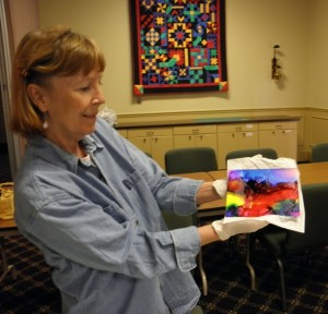 Uschi shows her alcohol ink painting